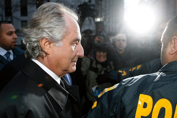 File of Bernard Madoff departing US Federal Court after a hearing in New York