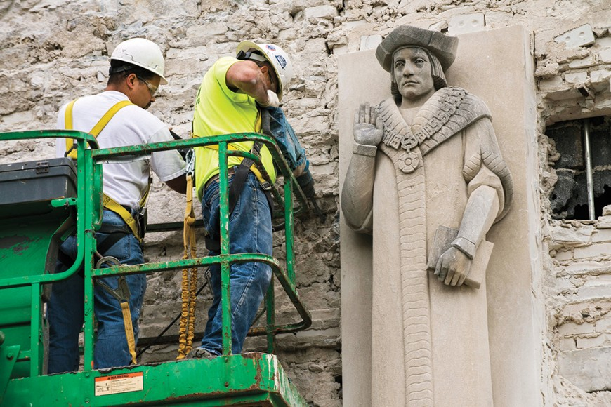 Stone workers from Salvucci starting the removal of the St. Thomas More relief figures from the exterior of the building before the building's demolition.