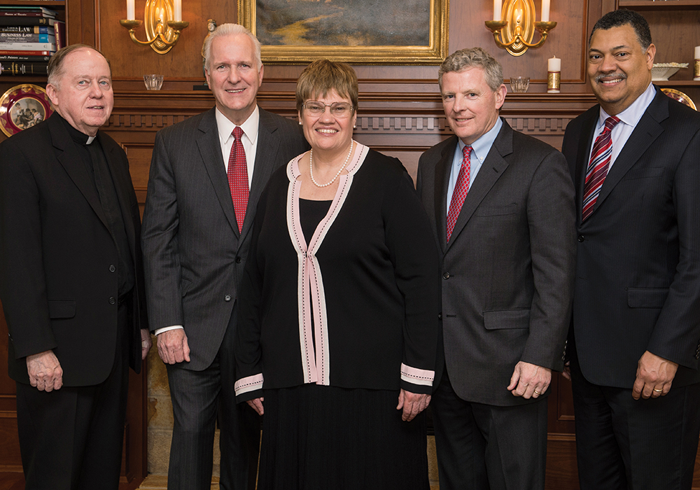 Professor Patricia McCoy with, from left, BC President William P. Leahy, SJ, past and present Liberty Mutual senior vice presidents Christopher Mansfield '75 and James Kelleher, and Dean Vincent Rougeau at the inauguration of the Liberty Mutual Insurance professorship.