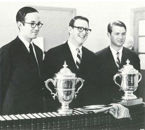 In 1968, Walt Kelly, center, after BC Law's first National Moot Court championship.