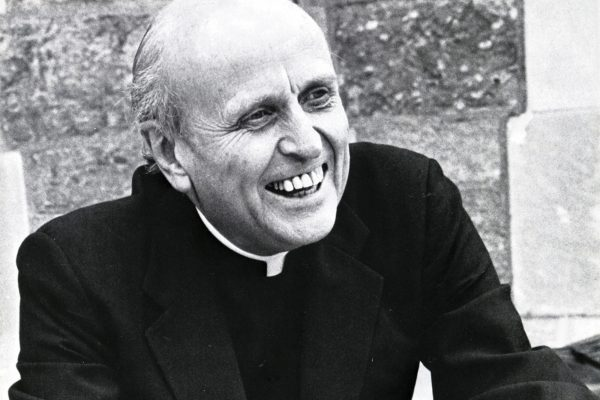 Robert Drinan, SJ (copy shot from Boston College Magazine) photographed on the steps of Burns Library.