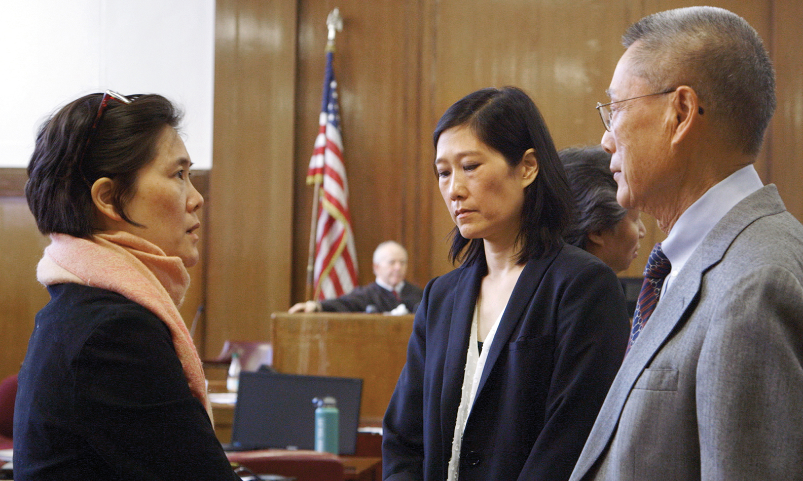 After a three-month trial, from left, Jill, Vera, and Thomas Sung await the verdict in the State Supreme Court in Manhattan.