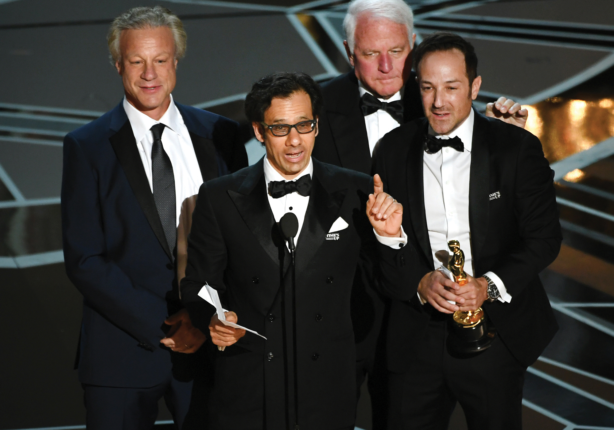David Fialkow, director Dan Cogan, producer James R. Swartz, and director Bryan Fogel accept Best Documentary Feature for Icarusduring the 90th Annual Academy Awards. Credit: Kevin Winter/Getty Images