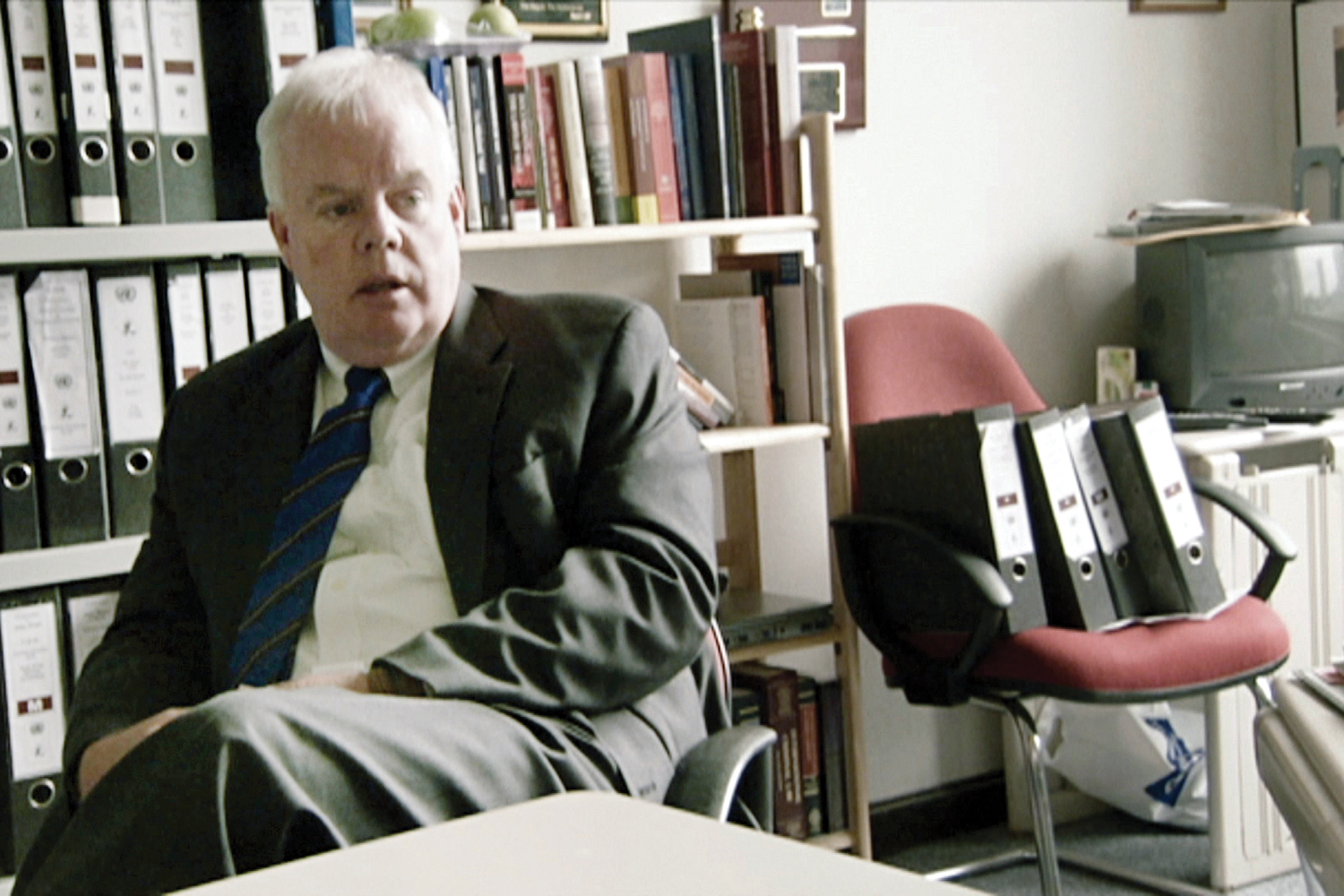 Dermot Groome '85, pictured in a scene from Frontline's documentary The Trial of Ratko Mladić.