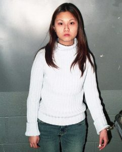 Choy at 17, chained and in custody.