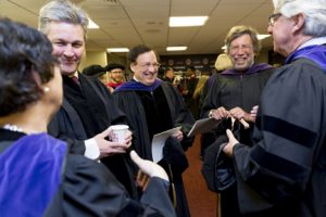 Kevin, second from right, with professors at Commencement.